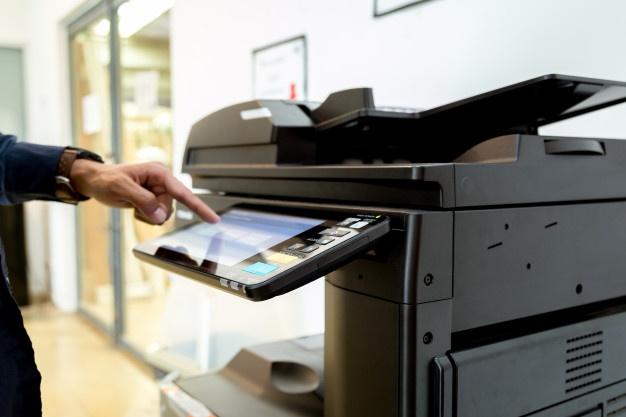 Business man pressing copier machine